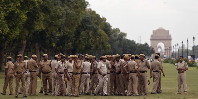 Police officers gather for a briefing near the India Gate in New Delhi.