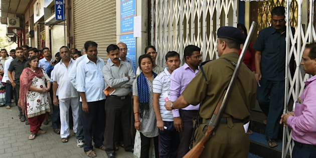Indians queue up outside the Bank of India branch to deposit and exchange 500 and 1000 currency notes in Mumbai on November 10, 2016.