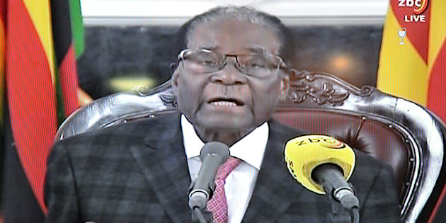This photograph taken on November 19, 2017, shows a television broadcasting Zimbabwe's President Robert Mugabe delivering a speech in Harare, following a meeting with army chiefs who have seized power in Zimbabwe.