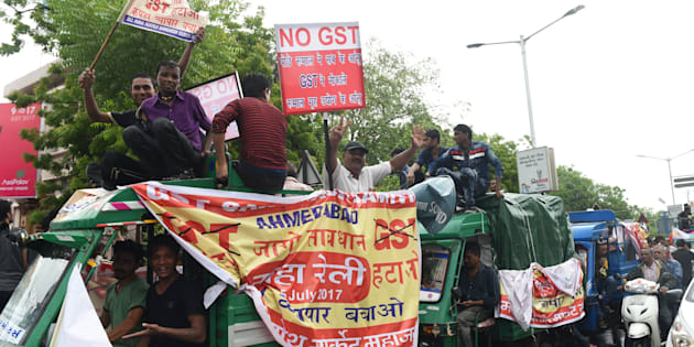 People connected with the textile industry participate in a protest rally against the recently introduced Goods and Service Tax (GST) in Ahmedabad on July 15, 2017.