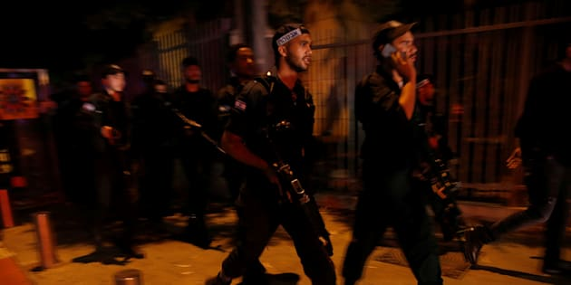 Israel security forcessearch the area following a shooting attack in the center of Tel Aviv on Wednesday.