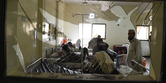 Pakistani victims injured in a suicide bombing are treated at a hospital in Quetta on 8 Aug.