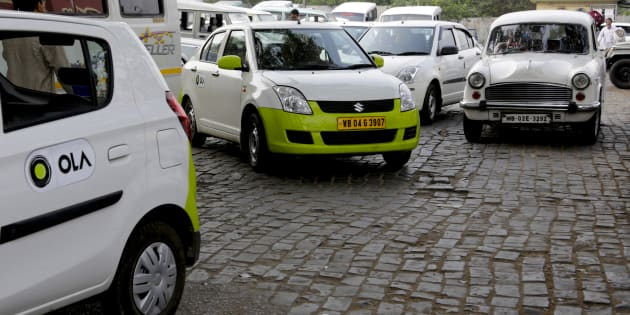 In this March 29, 2016 photo, Ola cabs, left, waiting for customers are parked next to other cars in Kolkata, India. Aiming to wrest control of Indias booming taxi market, two cab-hailing smartphone apps, Uber and Ola, are promising hundreds of millions in new investments while also facing off with one another in court. (AP Photo/ Bikas Das)