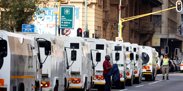A cash-in-transit worker arrives to attend a nationwide protest following a spate of deadly heists this year, in Johannesburg, South Africa, June 12, 2018. REUTERS/Siphiwe Sibeko
