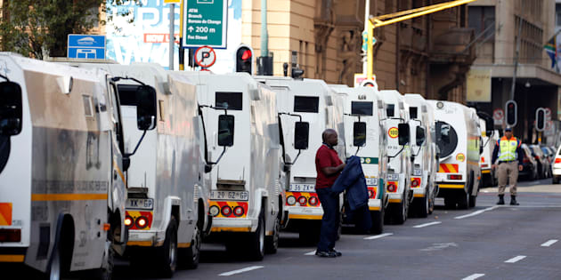 A cash-in-transit worker arrives to attend a nationwide protest following a spate of deadly heists this year, in Johannesburg, South Africa, June 12, 2018.