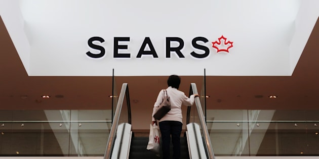 A woman takes an escalator to a Sears store in Mississauga, Ont., Oct. 6, 2017. Sears Canada began liquidation sales Thursday at its stores across the country as it prepares to shut its doors for good after 65 years.