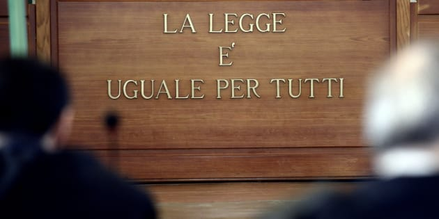 ROME, ITALY - OCTOBER 20: The sign 'La legge è uguale per tutti' ('The law is equal for everyone')  during the New trial against five military police officers for the death Stefano Cucchi on October 20, 2017 in Rome, Italy.