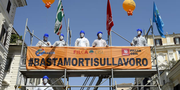 ROME, ITALY - APRIL 27: Stop Deaths at work! The trade unions CGIL, CISL and UIL in Piazza Santi Apostoli ask for safety at work with a flash mob wearing  masks and white suits on a scaffolding during the Safe Day 2018, on April 27, 2018 in Rome, Italy. (Photo by Simona Granati - Corbis/Corbis via Getty Images,)