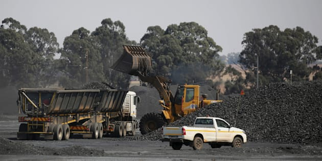 Coal is loaded onto a truck at the Woestalleen colliery near Middleburg in Mpumalanga province, September 8, 2015.