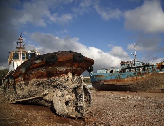 Greece hauls half-sunken ships out of the sea