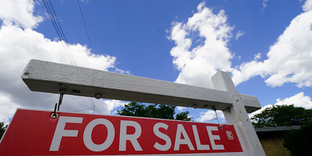 "A ""for sale"" sign is pictured in the front yard of a house in Toronto, July 17. The latest data from the Teranet/National Bank house price index shows house prices in Canada's largest cities have largely turned negative in the past few months."
