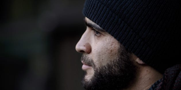 Omar Khadr speaks outside court in Edmonton on December 13, 2018.