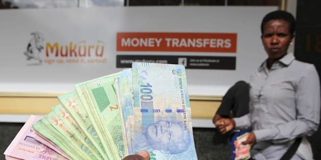 An  forex dealer offers bond notes and South African Rand outside a bank in the central business district in Harare, Zimbabwe, February 24, 2017.