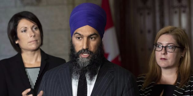 NDP leader Jagmeet Singh and MPs Karine Trudel, left, and Tracey Ramsey speak to reporters in the foyer of the House of Commons on Oct. 1, 2018.