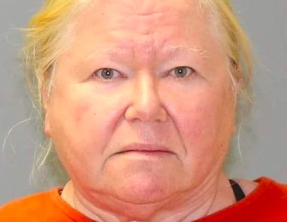 Woman charged after 44 dead dogs found in freezers