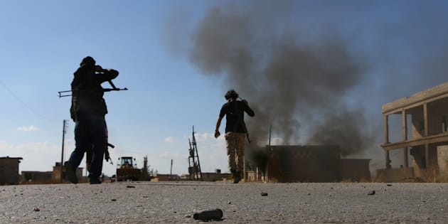 Fighters from the Free Syrian Army fight against the Islamic State (IS) group jihadists on the outskirts of the northern Syrian town of Dabiq, on October 15, 2016.