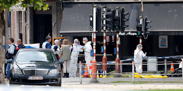 Police officers and forensics experts are seen on the scene of a shooting in Liege, Belgium, May 29, 2018.