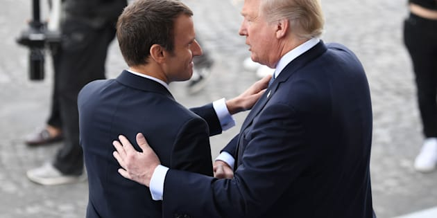 US President Donald Trump (R) and French President Emmanuel Macron shake hands at the end of the annual Bastille Day military parade on the Champs-Elysees avenue in Paris on July 14, 2017.   The parade on Paris's Champs-Elysees will commemorate the centenary of the US entering WWI and will feature horses, helicopters, planes and troops. / AFP PHOTO / ALAIN JOCARD        (Photo credit should read ALAIN JOCARD/AFP/Getty Images)