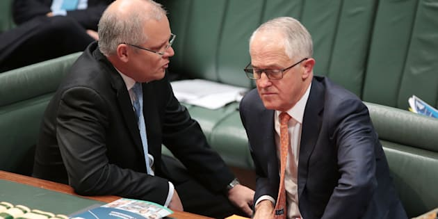 CANBERRA, AUSTRALIA - MAY 10:  Treasurer Scott Morrison speaks to Prime Minister Malcolm Turnbull during question time at Parliament House on May 10, 2017 in Canberra, Australia. The Turnbull Government's second budget has delivered additional funds to education, a plan to assist first home buyers, along with a crackdown on welfare.  (Photo by Stefan Postles/Getty Images)