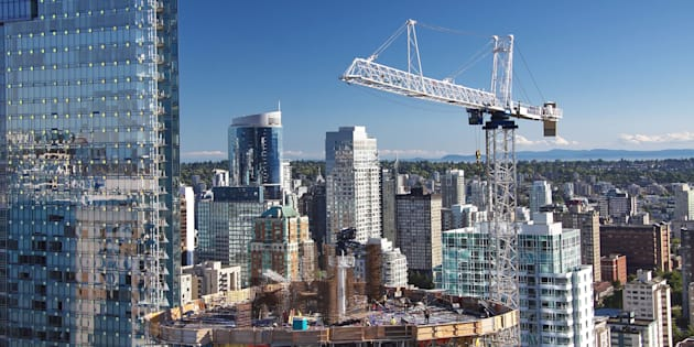 A high-rise building under construction in downtown Vancouver. Some experts say Canada's policymakers have successfully engineered a soft landing for the country's housing market.