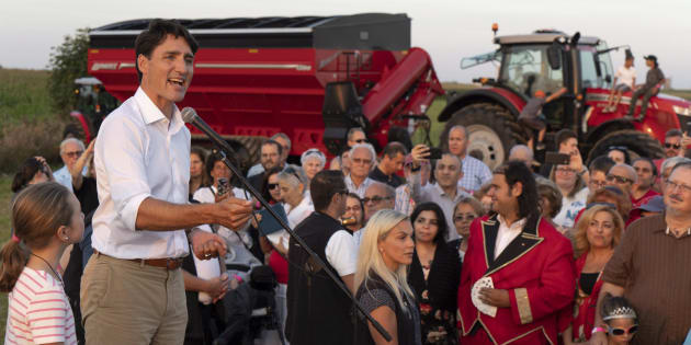 Prime Minister Justin Trudeau addresses local Liberals and Liberal MPs from the South Shore of Montreal for a summer corn roast in Sabrevois, Que., on Aug. 16, 2018.