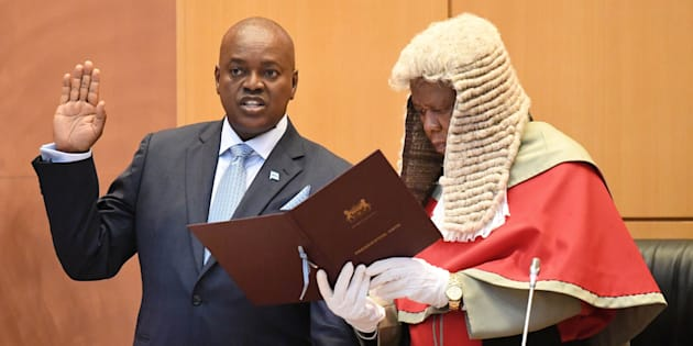 Botswana's new president, Mokgweetsi Masisi (L), takes the oath as the fifth president of Botswana in Gaborone on April 1, 2018, administered by chief Justice Maruping Dibotelo.