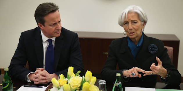 WASHINGTON, DC - JANUARY 15:  International Monetary Fund Managing Director Christine Lagarde (R) speaks as  British Prime Minister David Cameron (L) listens during a meeting at the IMF headquarters January 15, 2015 in Washington, DC. Prime Minister Cameron is on a two-day visit to Washington.  (Photo by Alex Wong/Getty Images)