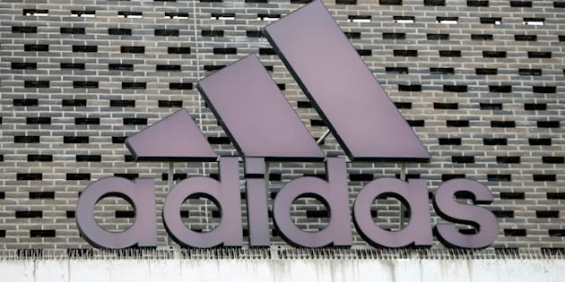The logo of Adidas is seen on an outlet store in Metzingen, Germany, June 16, 2017.  REUTERS/Michaela Rehle