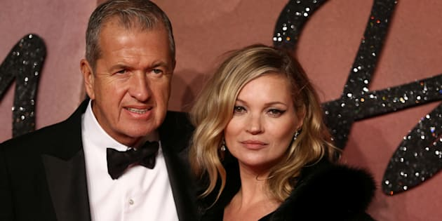 Model Kate Moss and photographer Mario Testino (L) pose for photographers at the Fashion Awards 2016 in London, Britain December 5, 2016. REUTERS/Neil Hall