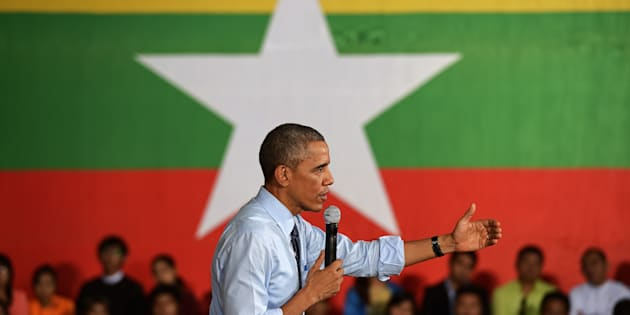 Former US President Barack Obama speaks at a Young Southeast Asian Leaders Initiative (YSEALI) town hall meeting at Yangon University's Diamond Jubilee Hall in Yangon on November 14, 2014.
