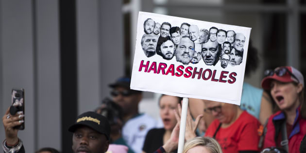Protesters attend a Me Too rally to denounce sexual harassment and assaults of women in Los Angeles, California on November 12, 2017.