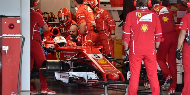Ferrari's German driver Sebastian Vettel waits for repairs in the pit during the Formula One Japanese Grand Prix at Suzuka Circuit on October 8, 2017. REUTERS/Kazuhiro Nogi/Pool