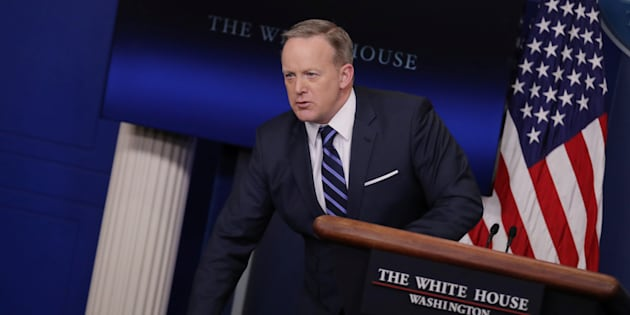 Sean Spicer with his piles of paper