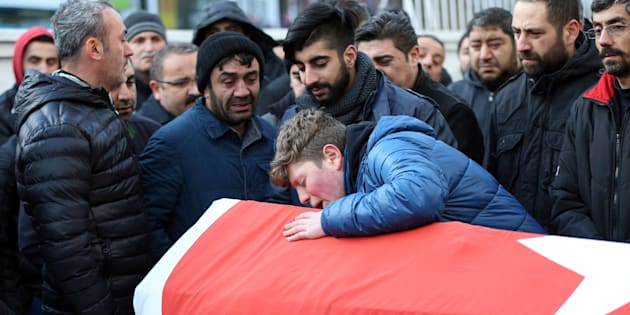 Family members and friends mourn as they attend funeral prayers for Ayhan Akin, one of the nightclub victims, in Istanbul, Sunday, Jan. 1, 2017. An assailant believed to have been dressed in a Santa Claus costume and armed with a long-barrelled weapon, opened fire at a nightclub in Istanbul's Ortakoy district during New Year's celebrations, killing dozens of people and wounding dozens of others in what the province's governor described as a terror attack. (AP Photo)