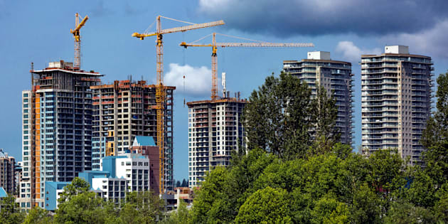 Residential towers under construction in New Westminster, B.C. Canada's housing market slowdown, which began with a drop in sales, is now spreading to home construction.