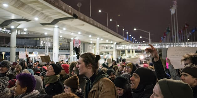 Thousands fill the street outside Terminal 5 of O'Hare International Airport in Chicago in protest of President Trump's order to ban people from seven predominantly Muslim countries from entering the United States.