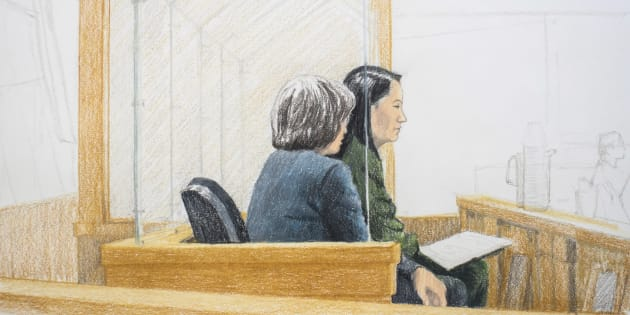 In this courtroom sketch, Meng Wanzhou, right, the chief financial officer of Huawei Technologies, sits beside a translator during a bail hearing at British Columbia Supreme Court in Vancouver on Friday.