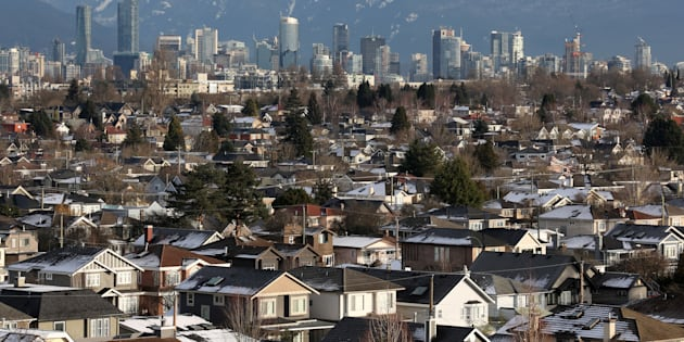 Single-family homes in Vancouver's Kitsilano neighbourhood, with downtown in the background, Jan. 7, 2017. Vancouver councillors have voted to allow duplexes in most city neighbourhoods currently restricted to single-family homes.