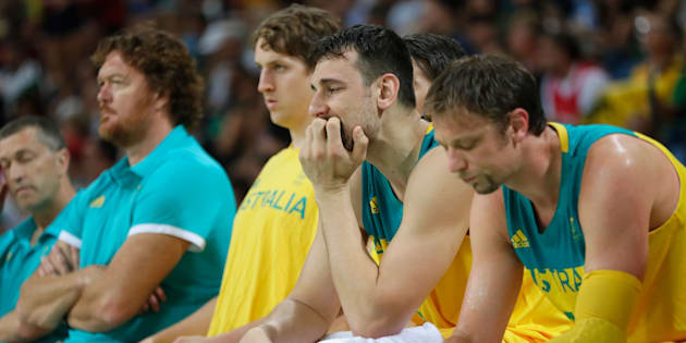 RIO DE JANEIRO, BRAZIL - AUGUST 19:  Andrew Bogut #6 of Australia reacts with teammates on the bench during the Men's Semifinal match against Serbia on Day 14 of the Rio 2016 Olympic Games at Carioca Arena 1 on August 19, 2016 in Rio de Janeiro, Brazil.  (Photo by Jamie Squire/Getty Images)
