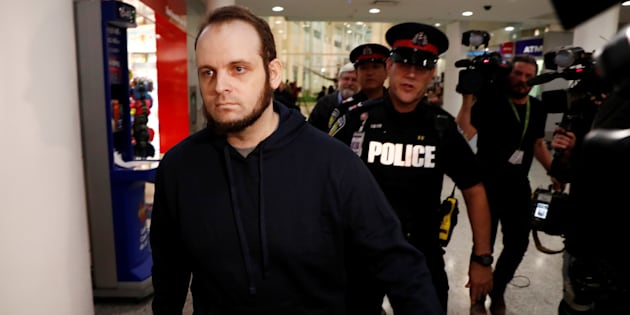Joshua Boyle walks through the airport after arriving with his wife and three children at Toronto Pearson International Airport on October 13, 2017.