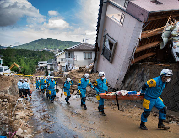 Japan struggles to get help to flood victims