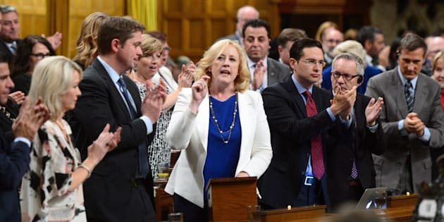 Conservative MP Lisa Raitt stands during question period in the House of Commons on Oct. 18, 2017.