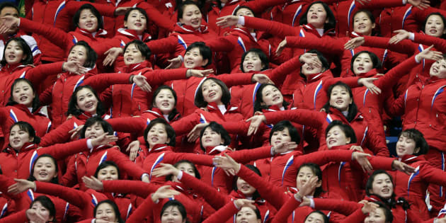 North Korean cheerleaders perform as Un Song Choe competes at the men's 1500 meters in the Gangneung Ice Arena at the 2018 Winter Olympics in Gangneung, South Korea on Feb. 10, 2018.