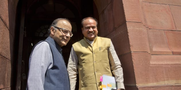 Indian Finance Minister Arun Jaitley, left, with Indian Minister for Chemicals and Fertilizers, Ananth Kumar, arrive at the parliament house in New Delhi, India, Aug. 3, 2017.