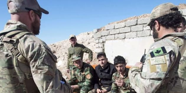 Canadian special forces soldiers speaking with Kurdish Peshmerga fighters in northern Iraq on Feb. 20, 2017.
