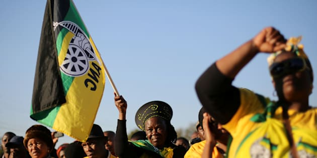Supporters of the African National Congress hold the party flag during ANC president Jacob Zuma's election campaign.