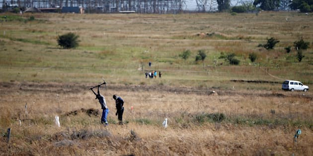 A man is seen digging to mark out vacant land in Olievenhoutbosch near Centurion in March 2018.