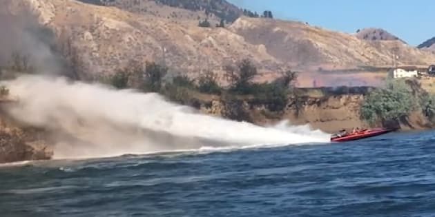 Koyne Watson and Tasha Hunt used their jet boat to try and put out a grass fire east of Kamloops, B.C.