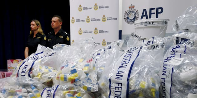 A quantity of liquid methamphetamine disguised in various packaging is put on display by Australian Border Force officers at the Australian Federal Police headquarters in Sydney, February 15, 2016.