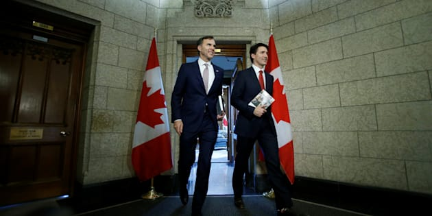 Prime Minister Justin Trudeau and Finance Minister Bill Morneau walk from Trudeau's office to deliver the budget on Parliament Hill on March 22, 2017.